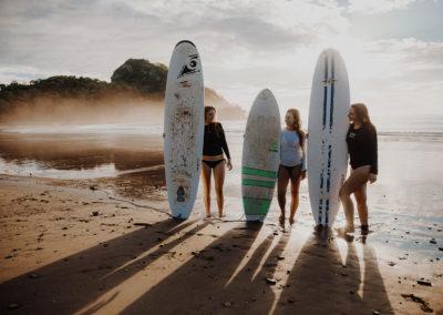 Backlit Surfers on beach